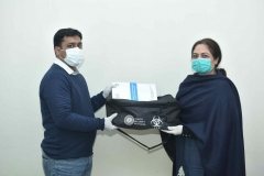 Participant receiving PPE kit after completion of BRM online training